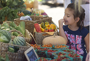 Child with Fresh Vegetables